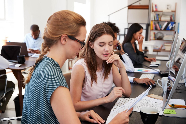 woman-training-new-female-employee-in-an-open-p2jta6y